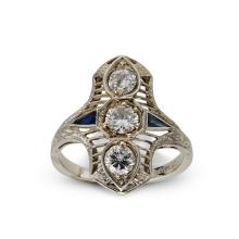 A diamond, synthetic sapphire and platinum ring,