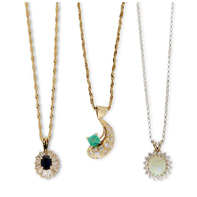 A collection of three gemstone, diamond and gold pendants with chains,