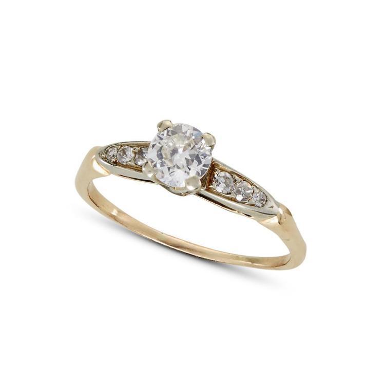 A diamond and fourteen karat gold ring,