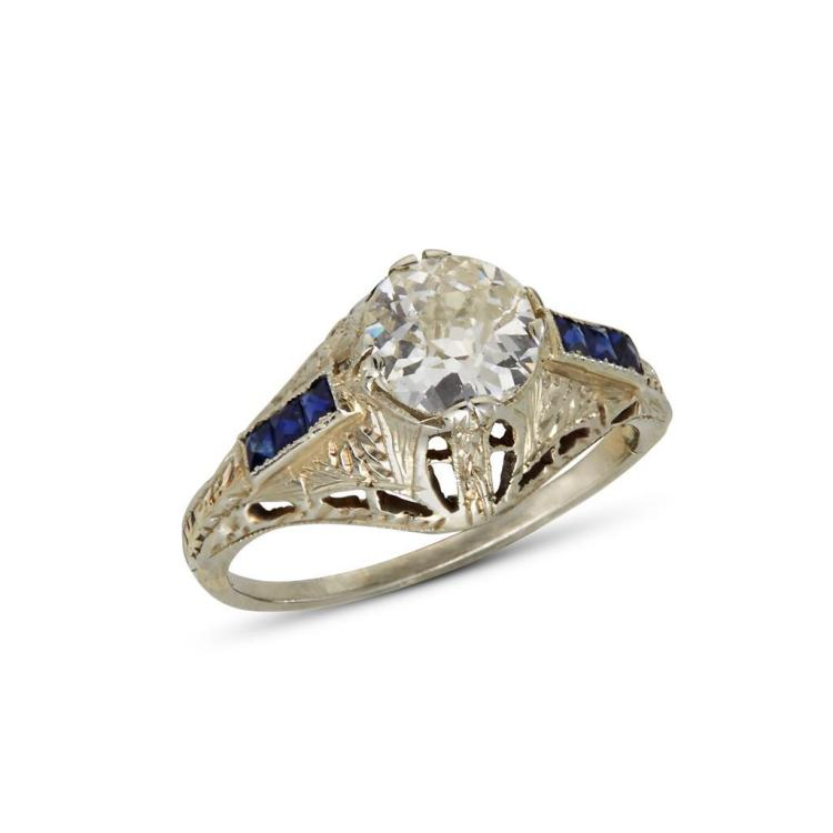 A diamond, synthetic sapphire and twenty karat white gold ring,