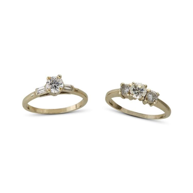 A collection of two diamond and fourteen karat white gold rings,