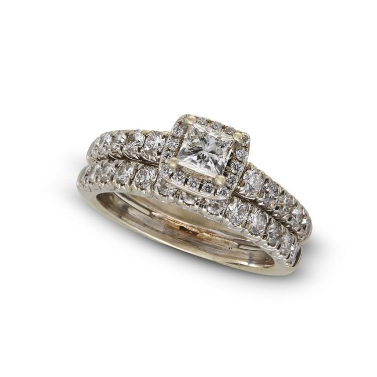 A diamond and fourteen karat white gold ring and matching band,