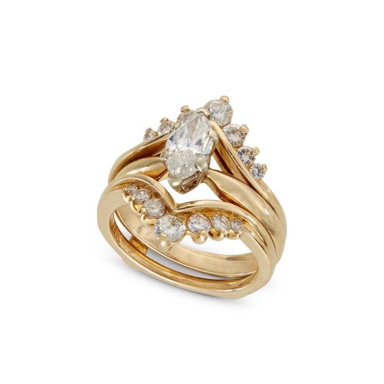 A diamond and fourteen karat gold ring with fitted guard,