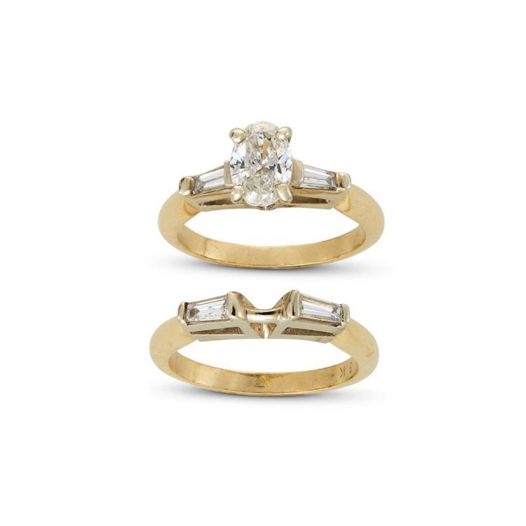 A diamond and eighteen karat two tone gold ring and matching band,