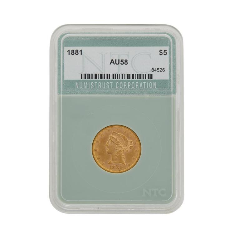 A five dollar American gold coin,