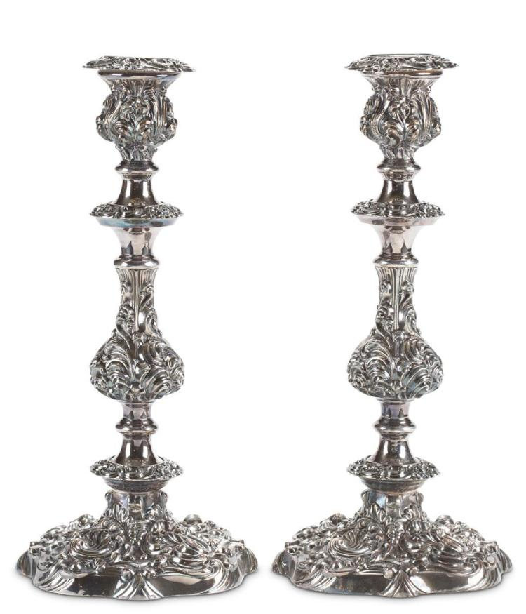 A pair of silver repousse candlesticks,