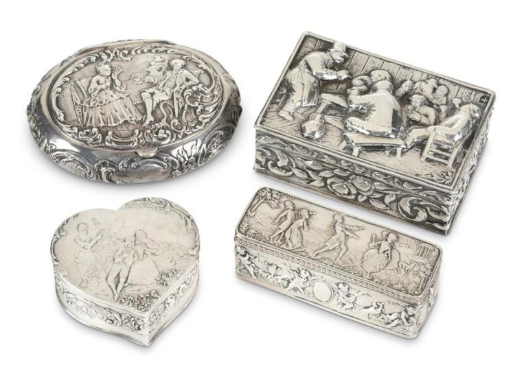 Collection Four silver figural relief boxes,
