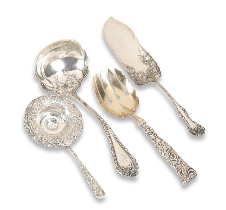 An assortment of four sterling silver serving pieces,