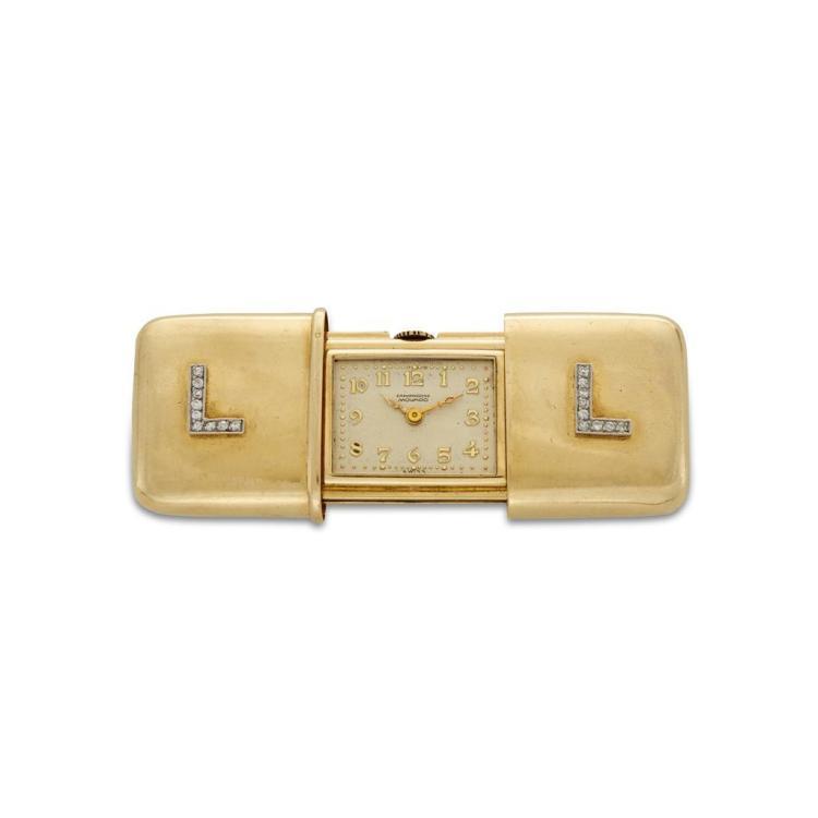 An eighteen karat gold and diamond purse watch, Movado, ermeto