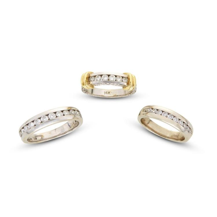 A collection of three diamond and gold bands,
