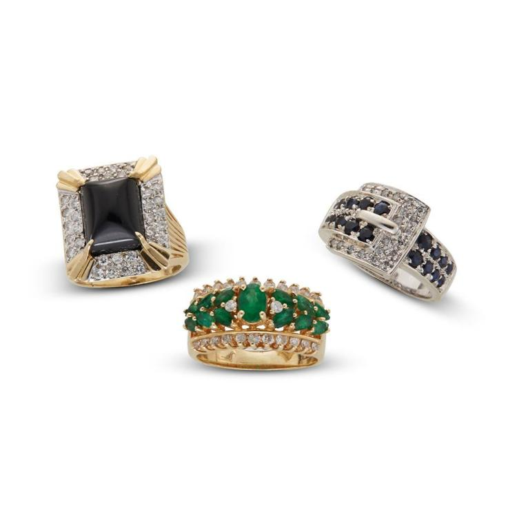 A collection of emerald, sapphire, black onyx, diamond and gold rings,