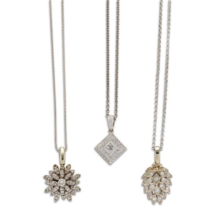 A collection of diamond and white gold pendants with chains,