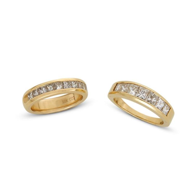 A collection of diamond and gold bands,