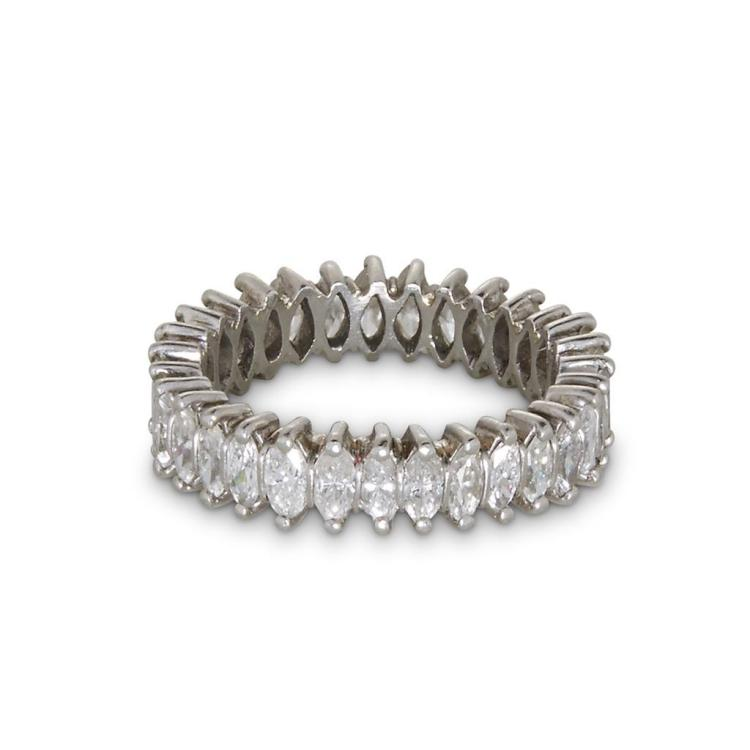 A diamond and platinum eternity band,