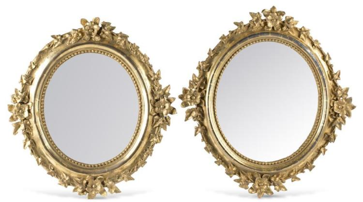 A pair of Louis XVI style carved giltwood mirrors, french, 19th century