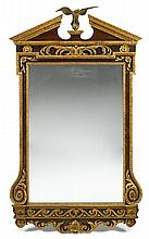 Fine George II parcel gilt mahogany mirror, 18th century, The broken pediment top centered by a cast brass eagle, the rectangular mirro