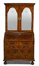 George II featherbanded walnut secretaire bookcase, mid 18th century and later, In two sections, the ogee molded cornice over twin arch