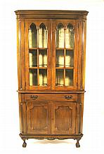 Pair of George III style walnut corner cupboards, 20th century, The triangular shaped top over conforming case in two parts: the upper