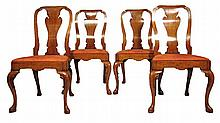 Set of four George II style walnut side chairs, , The rounded and shaped backs over vasiform splats, drop-in seat, raised on cabriole l