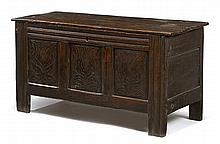Charles II carved oak coffer, circa 1680, The rectangular two-plank lift top over three panels to the front, each carved with tulip blo