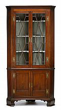 George III mahogany corner cupboard, circa 1790, The dentil-molded cornice above twin astragal glazed doors opening to painted interior