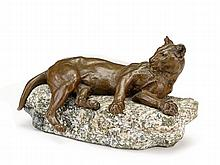 Charles Valton (French, 1851 - 1918), lion, Bronze, mid-brown patina, modeled reclining on granite base, the base signed in red