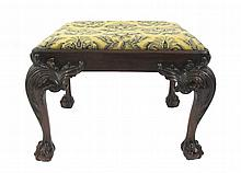 George III style walnut stool, 20th century, The rectangular slip seat in wool upholstery raised on acanthus leaf carved cabriole legs