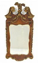George II walnut and giltwood mirror, mid 18th century, The rosette carved swan neck pediment centered by a carved giltwood eagle over