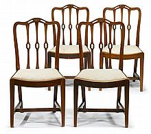 Set of four George III style mahogany dining chairs, 19th century, The undulating and openwork crest rail centered by carved paterae, a
