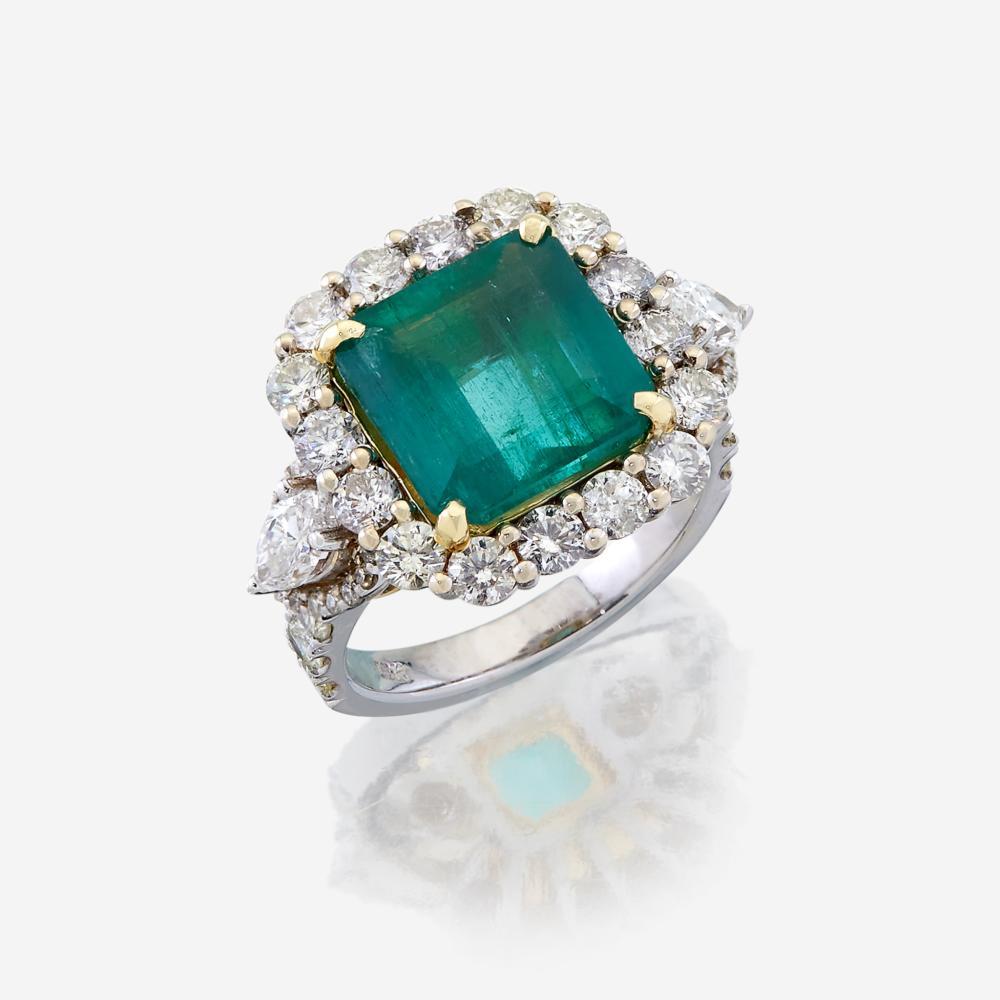 An emerald, diamond, and eighteen karat white gold ring