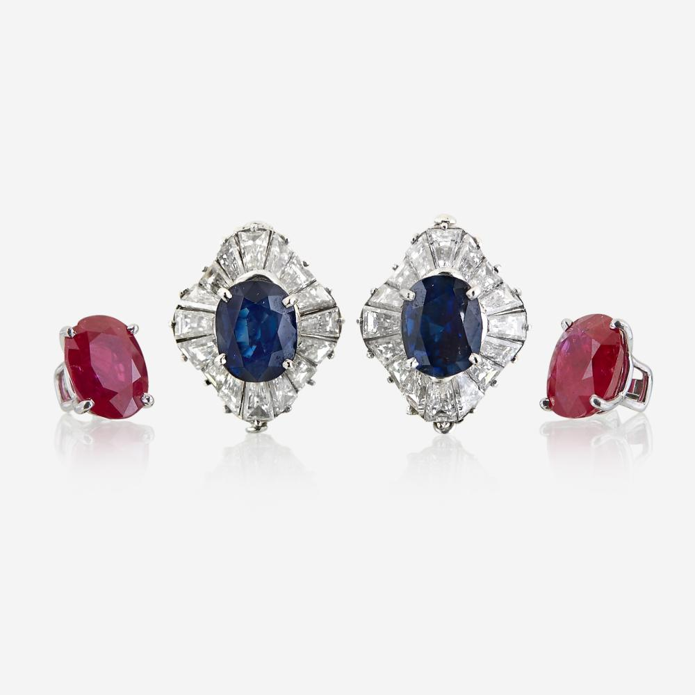 A pair of diamond and platinum earring jackets with interchangeable ruby and sapphire studs
