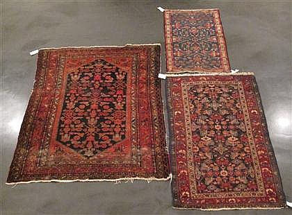 Three West Persian rugs, circa 1st quarter 20th century, A Hamadan rug, 5 ft. 3 in. x 3 ft. 5 in.; a Lilihan rug, 4 ft. x 2 ft. 7 in.;