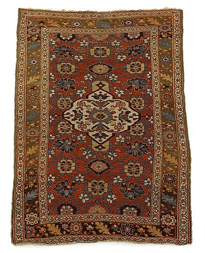 Two Persian rugs: a Khamseh rug, Southwest Persia, dated 1898, 6 ft. 7 in. x 3 ft. 7 in.; and a Kurd Bidjar rug, West Persia, circa 190