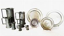 Seven assembled pewter measures and four varisized small plates, ,