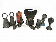 Collection of tin lighting devices, 19th and 20th century,