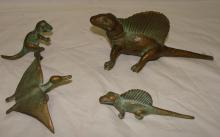 Set of cast iron dinosaurs by S.R.C. co. 1947