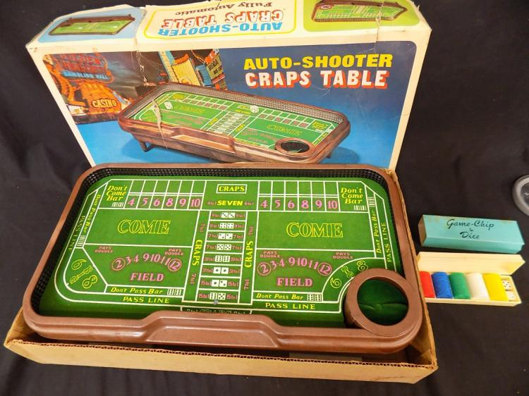 Automatic shooter craps table