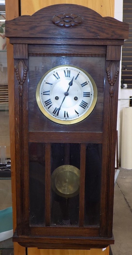 antique wooden wall clock with side windows
