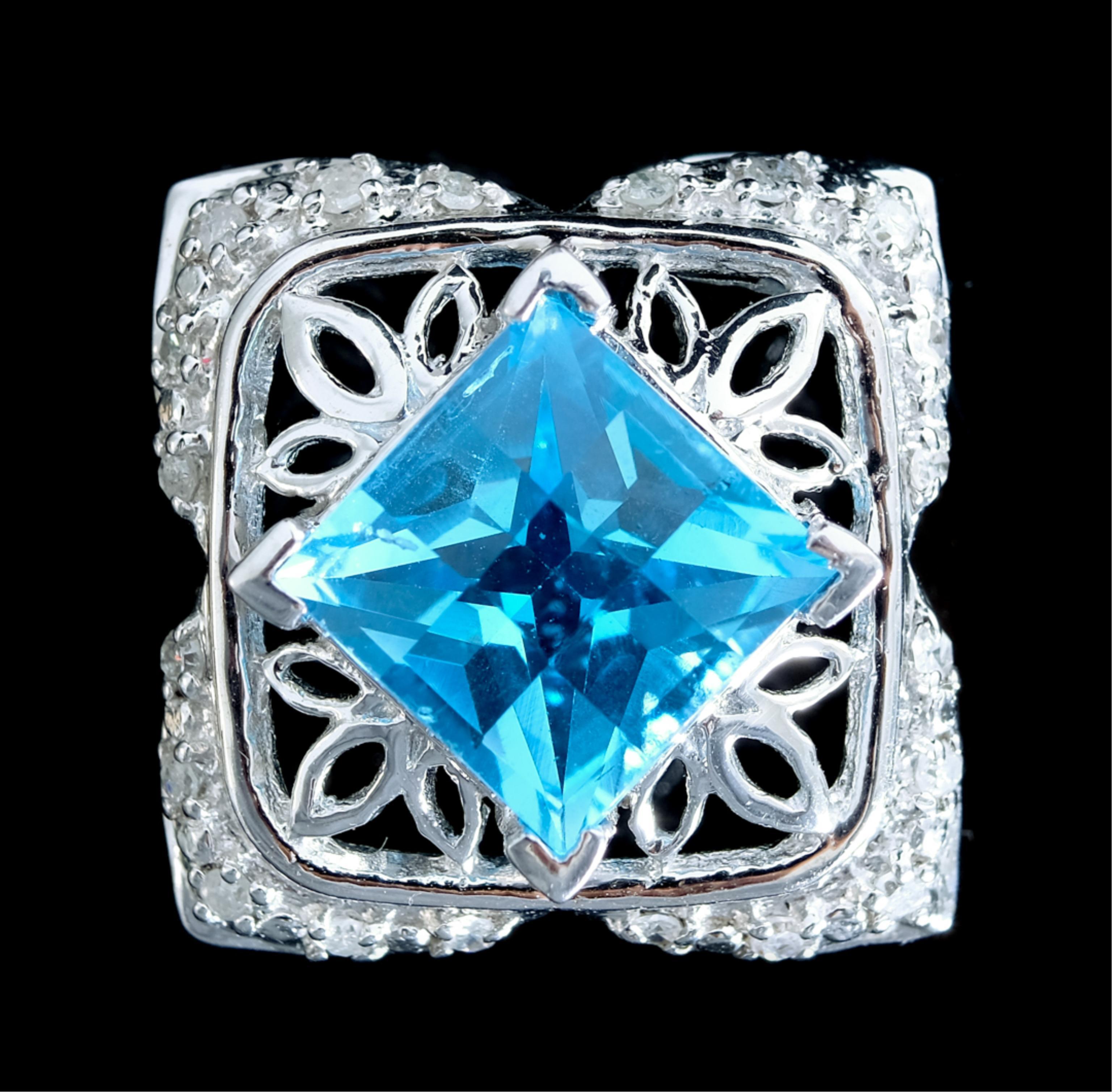 14k White Gold Blue Topaz & Diamond Pendant