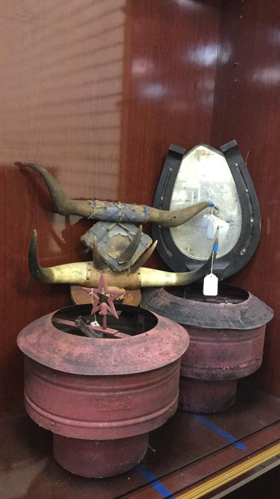 Pair of large Red metal star vents, cow horn wall