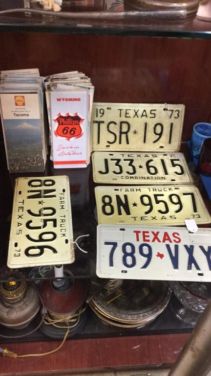 Selection of old license plates and road maps