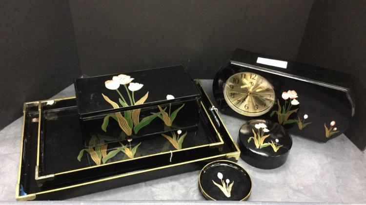 Black lacquer dresser set with clock, trays,
