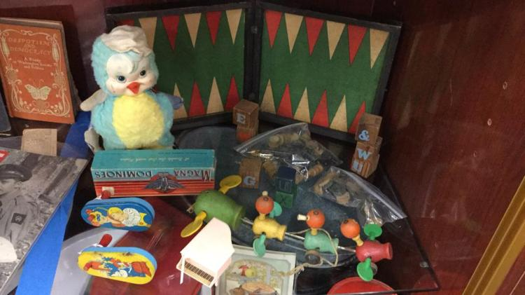 Selection of vintage toys, and checker pieces