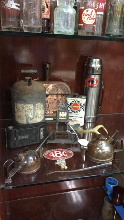 Selection of vintage metal oil cans, iron base
