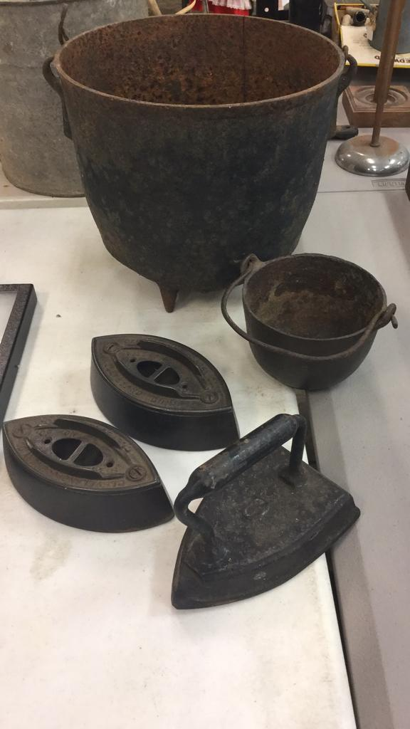 Selection of cast-iron pots, iron and weights