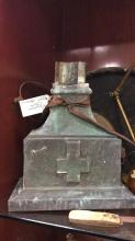 Selection of primitive items, old canteen lamp