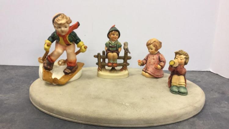 Selection of Goebel Hummel TMK5 figures with