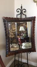 Antique highly carved beveled wood mirror