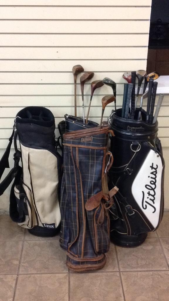 Selection of golf bags and clubs