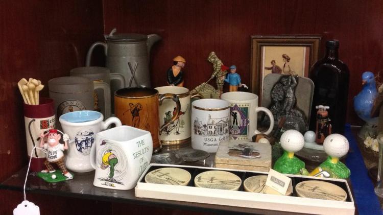 Selection of gold mugs, vintage metal bank,